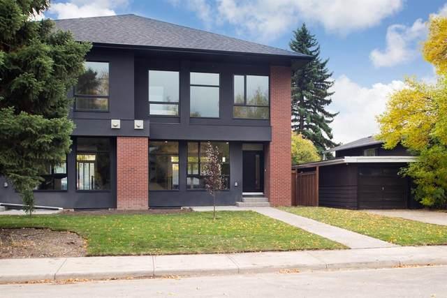 52 Heston Street NW, Calgary, AB T2K 2C1 (#A1033914) :: Canmore & Banff