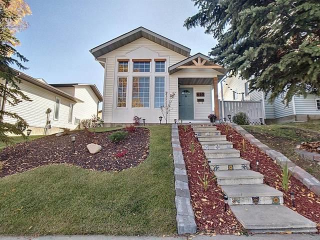 680 Macewan Drive NW, Calgary, AB T3K 3J5 (#A1039782) :: Redline Real Estate Group Inc