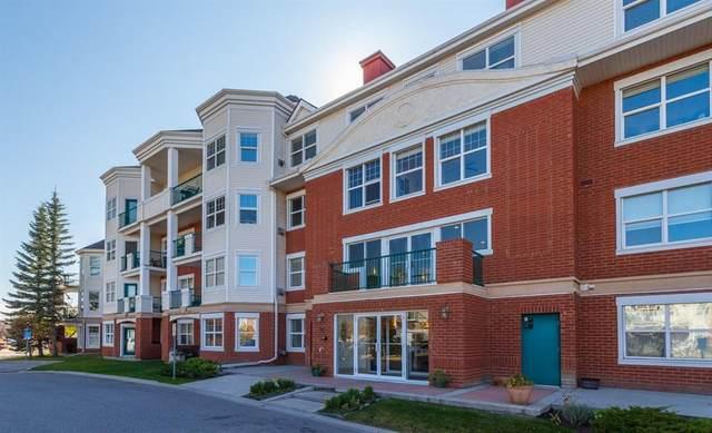 78 Prestwick Gardens SE #411, Calgary, AB T2Z 3V2 (#A1042112) :: Western Elite Real Estate Group