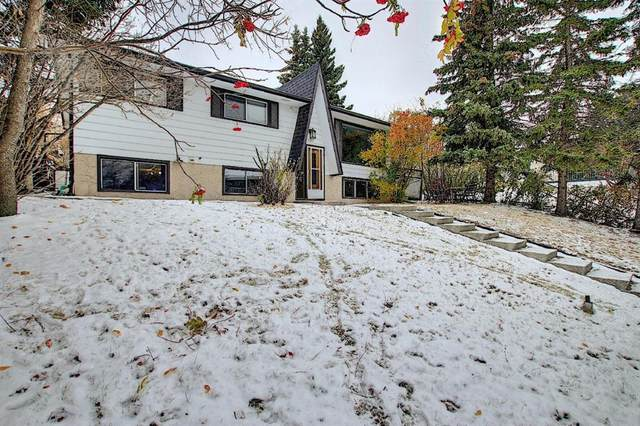 7539 Hunterview Drive NW, Calgary, AB T2K 4P7 (#A1043546) :: Canmore & Banff
