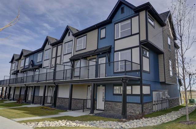 850 Belmont Drive SW #205, Calgary, AB T2X 4A5 (#A1045954) :: Greater Calgary Real Estate