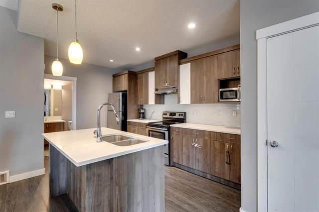 67 Baysprings Way SW, Airdrie, AB T4B 4C4 (#A1087211) :: Calgary Homefinders