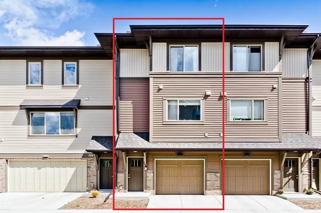 32 Horseshoe Crescent #703, Cochrane, AB T4C 2P4 (#A1106529) :: Calgary Homefinders