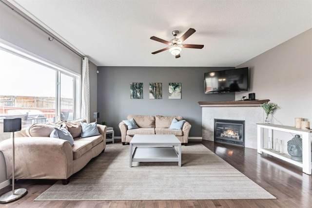234 Fireside Place, Cochrane, AB T4C 0R6 (#A1112001) :: Calgary Homefinders