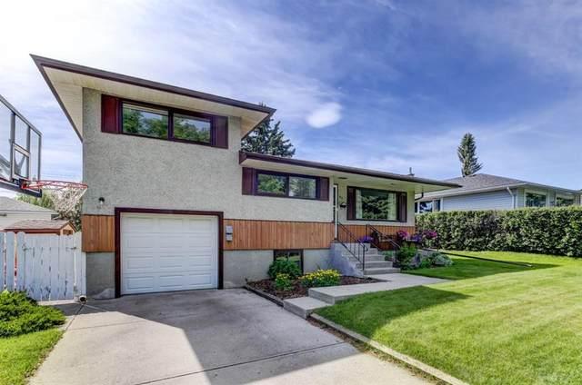 67 Chancellor Way NW, Calgary, AB T2K 1Y3 (#A1118137) :: Calgary Homefinders