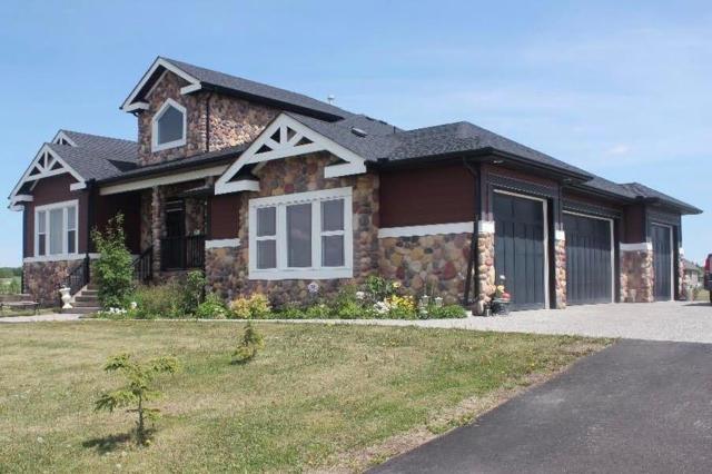 32085 Kodiak Springs Road, Rural Rocky View County, AB T4C 0B6 (#C4226060) :: The Cliff Stevenson Group