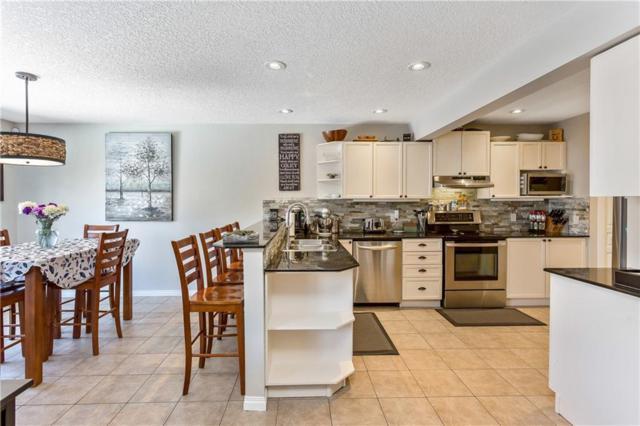 108 Crystal Shores Manor, Okotoks, AB T1S 2H6 (#C4237941) :: Redline Real Estate Group Inc