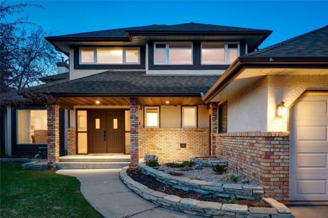 520 Coach Grove Road SW, Calgary, AB T3H 1J4 (#C4242125) :: Redline Real Estate Group Inc