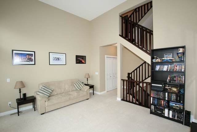 28 Heritage Drive #115, Cochrane, AB T4C 0K1 (#C4247793) :: Redline Real Estate Group Inc