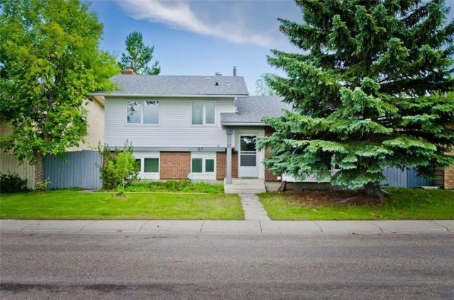 87 Woodford Crescent SW, Calgary, AB T2W 4C6 (#C4257963) :: Redline Real Estate Group Inc
