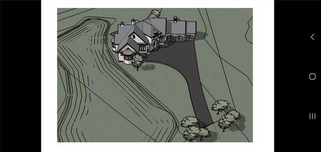 39 Mckendrick Run, Rural Rocky View County, AB T3Z 3K1 (#C4266392) :: The Cliff Stevenson Group