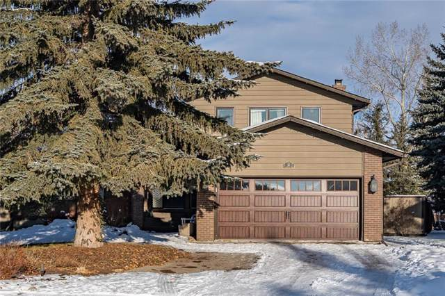 32 Woodgreen Crescent SW, Calgary, AB T2W 4A5 (#C4279826) :: Redline Real Estate Group Inc