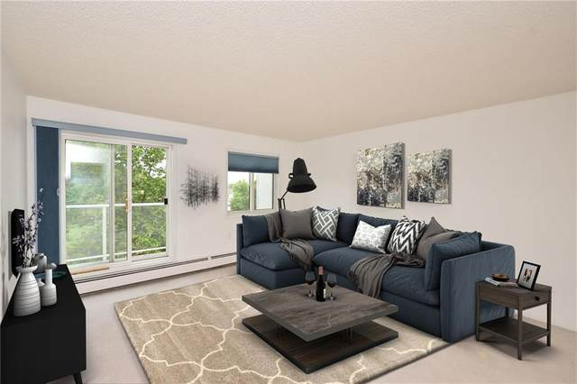 309 Woodside Drive NW #310, Airdrie, AB T4B 2E7 (#C4289019) :: The Cliff Stevenson Group