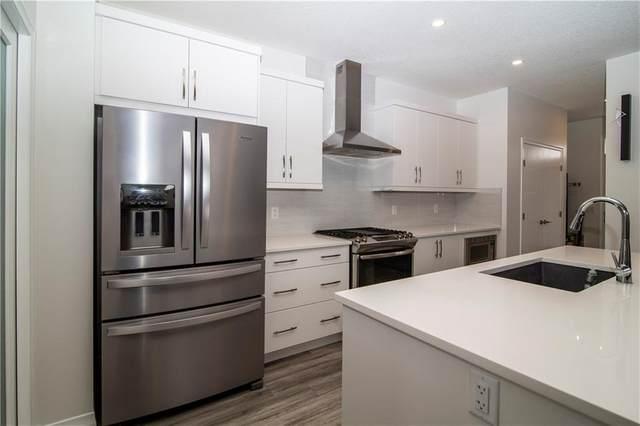 108 Wolf Creek Manor SE, Calgary, AB T2X 4A1 (#C4292445) :: Calgary Homefinders