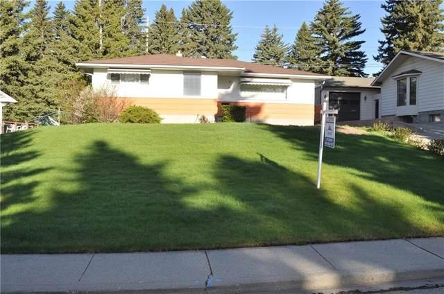 30 Roselawn Crescent NW, Calgary, AB T2K 1K6 (#C4295786) :: The Cliff Stevenson Group
