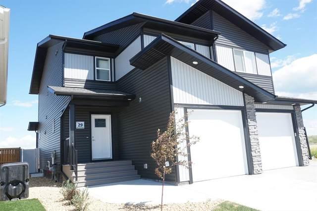 29 Iron Gate Boulevard, Sylvan Lake, AB T4S 0B6 (#CA0192598) :: Canmore & Banff