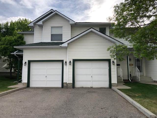 13 Sandpiper Lane NW, Calgary, AB T3K 4L7 (#A1105908) :: Western Elite Real Estate Group