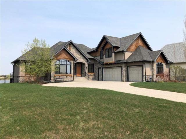 7 Montenaro Bay, Rural Rocky View County, AB T4C 0A5 (#C4233547) :: Redline Real Estate Group Inc