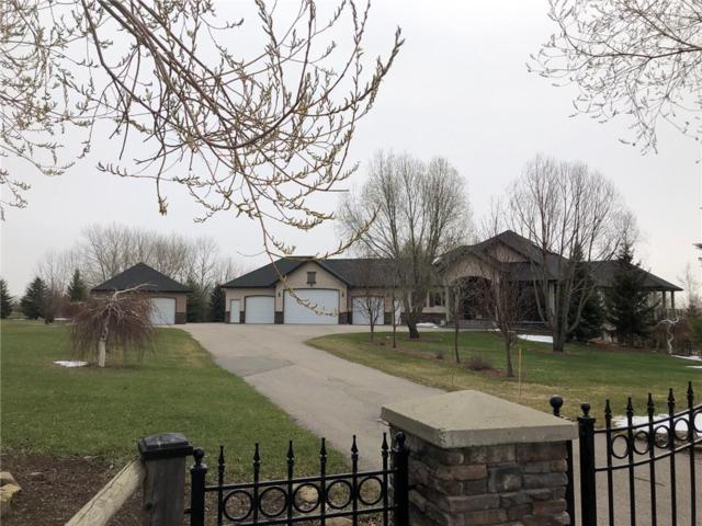 249050 Country Meadows Place E #100, Rural Foothills County, AB T1S 3R3 (#C4233574) :: The Cliff Stevenson Group