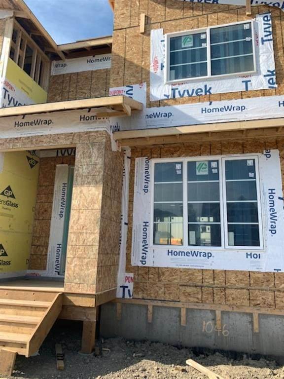 1046 Carrington Boulevard, Calgary, AB T3P 1L8 (#A1018447) :: Redline Real Estate Group Inc