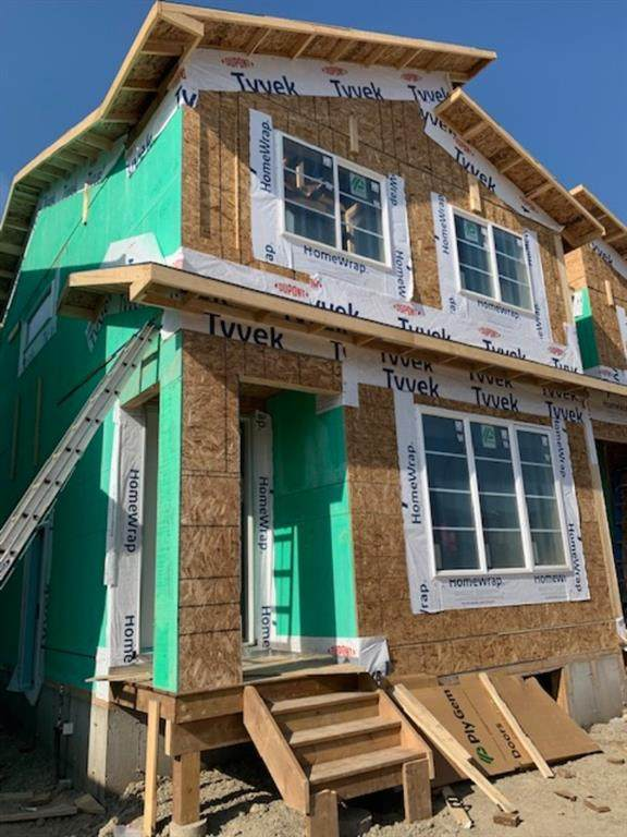 1050 Carrington Boulevard, Calgary, AB T3P 1L8 (#A1018453) :: Redline Real Estate Group Inc