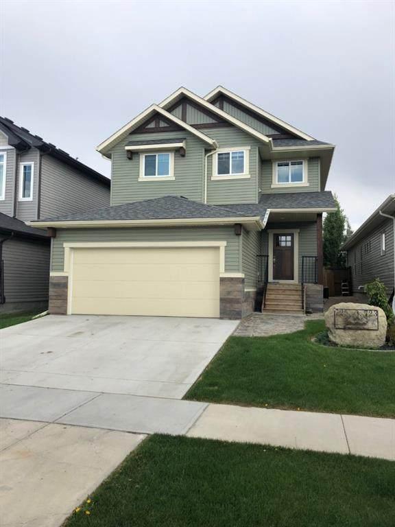 725 Hampton Hills Drive, High River, AB T1V 0E6 (#A1019530) :: Redline Real Estate Group Inc