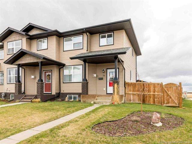 74 Terrace Heights Drive, Lacombe, AB T4L 2L8 (#A1026348) :: Canmore & Banff