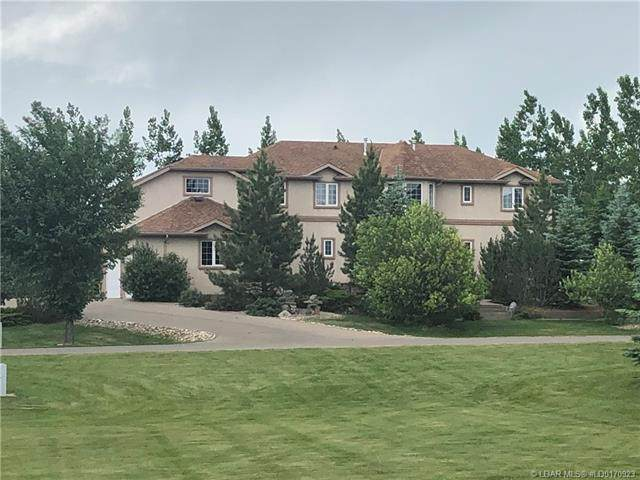 16 Sandstone Road S, Lethbridge, AB T1K 7X8 (#A1033981) :: Redline Real Estate Group Inc