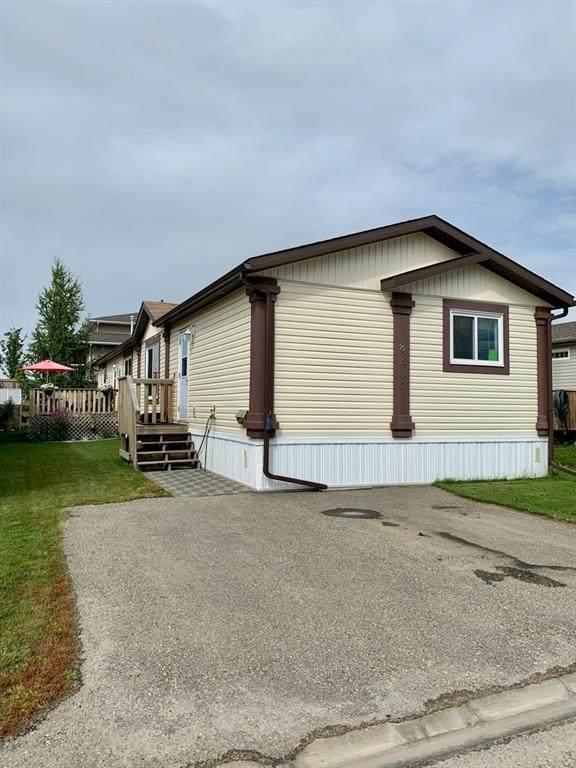 8830 90 Avenue, Grande Prairie, AB T8X 0G1 (#A1038659) :: Canmore & Banff