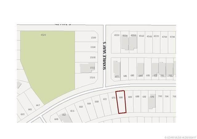 680 Sixmile Crescent S, Lethbridge, AB T1K 6Z9 (#A1040718) :: Redline Real Estate Group Inc