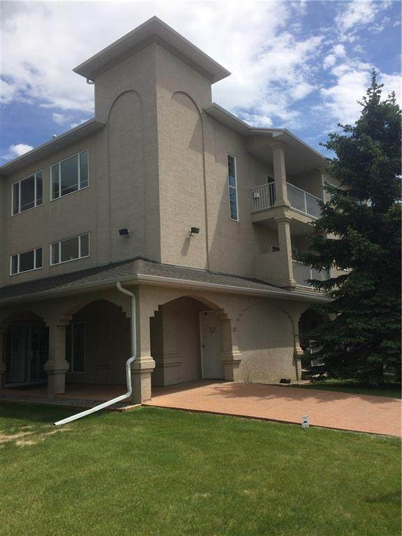 15 Lineham Avenue #305, Okotoks, AB T1S 1A1 (#A1049608) :: Redline Real Estate Group Inc
