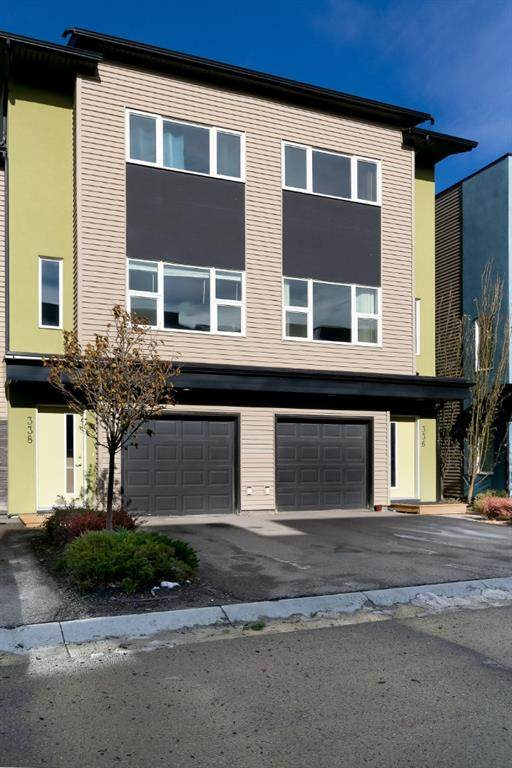 338 Covecreek Circle, Calgary, AB T3K 0W6 (#A1052281) :: Redline Real Estate Group Inc
