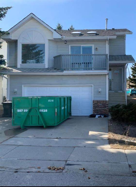 51 Sanderling Close NW, Calgary, AB T3K 2Z7 (#A1087970) :: Western Elite Real Estate Group