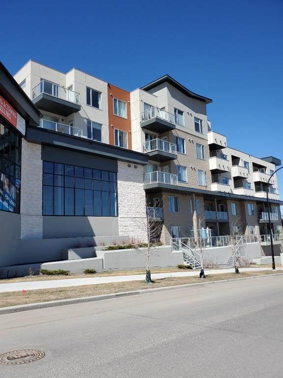 30 Shawnee Common SW #209, Calgary, AB T2Y 0R1 (#A1093637) :: Redline Real Estate Group Inc