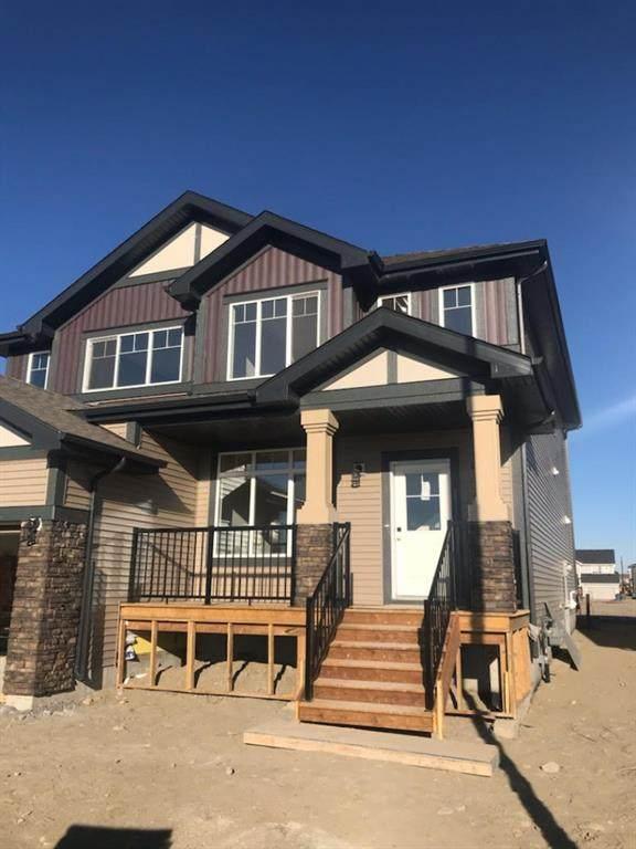 101 Heartland Street, Cochrane, AB T4C 2P8 (#A1095665) :: Calgary Homefinders