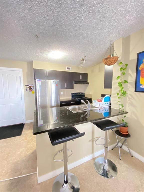 355 Taralake Way NE #321, Calgary, AB T3J 0M1 (#A1096259) :: Redline Real Estate Group Inc