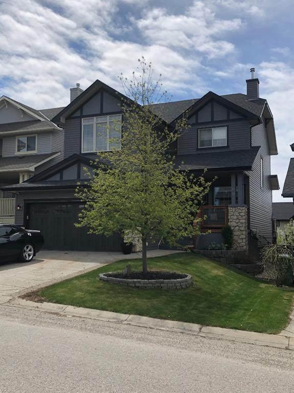 209 Hidden Creek Road NW, Calgary, AB T3A 6L1 (#A1111636) :: Calgary Homefinders