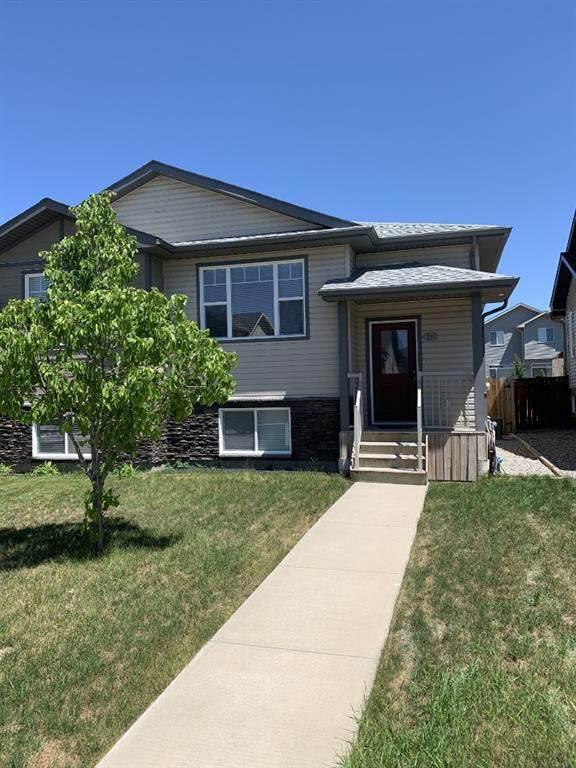 131 Mt Sundance Crescent W, Lethbridge, AB T1K 0L4 (#A1120338) :: Calgary Homefinders