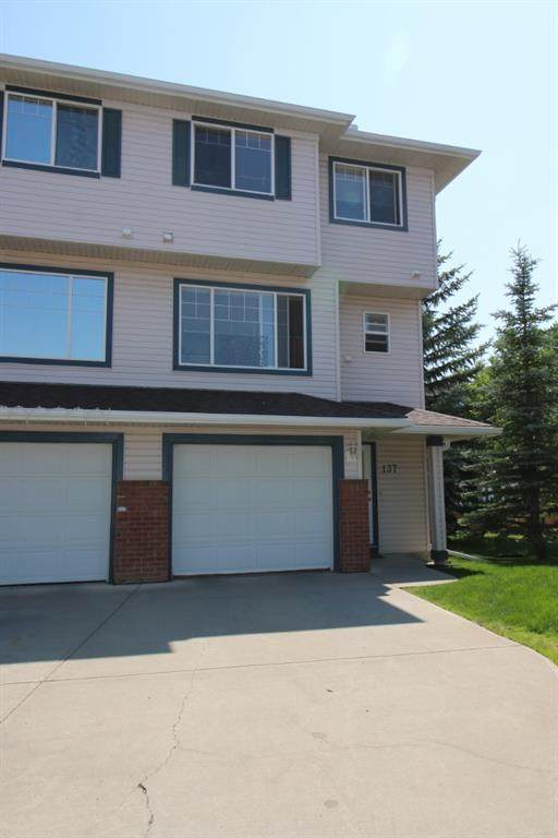 137 Rocky Ridge Court NW, Calgary, AB T3G 4S7 (#A1129067) :: Calgary Homefinders