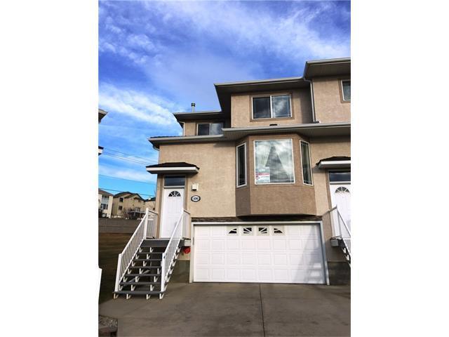 106 Country Hills Gardens NW, Calgary, AB T3K 5G2 (#C4149105) :: The Cliff Stevenson Group