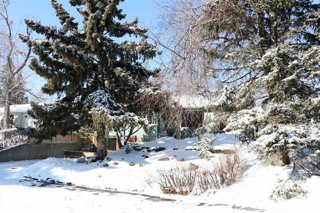 7111 Hunterwood Road NW, Calgary, AB T2K 4J5 (#C4172622) :: Canmore & Banff
