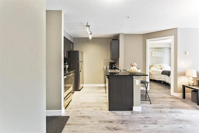 403 Mackenzie Way SW #8109, Airdrie, AB T4B 3V7 (#C4177942) :: Canmore & Banff