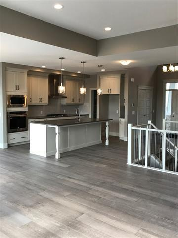 9 Artesia Point(E), Heritage Pointe, AB T1S 4K6 (#C4186067) :: Redline Real Estate Group Inc