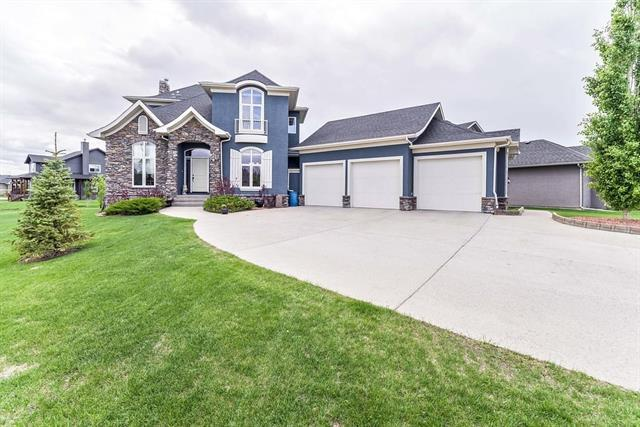 107 Montenaro Crescent, Rural Rocky View County, AB T4C 0A7 (#C4188926) :: Redline Real Estate Group Inc