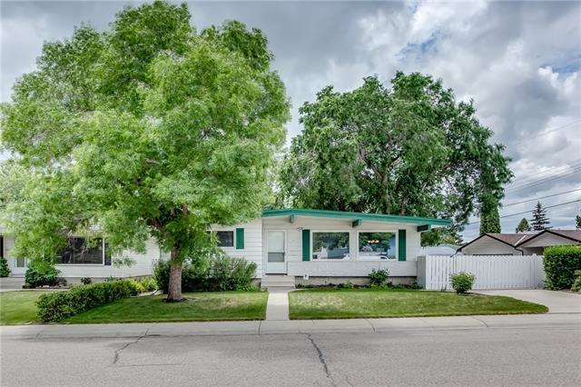 107 Huntcroft Way NE, Calgary, AB T2K 4E4 (#C4191549) :: Your Calgary Real Estate