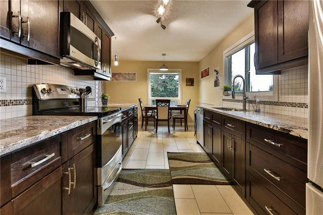 8003 Ranchview Drive NW, Calgary, AB T3G 1S7 (#C4195429) :: Tonkinson Real Estate Team