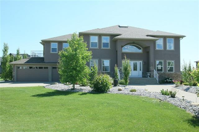 206 Montenaro Place, Rural Rocky View County, AB T4C 0A7 (#C4222309) :: The Cliff Stevenson Group