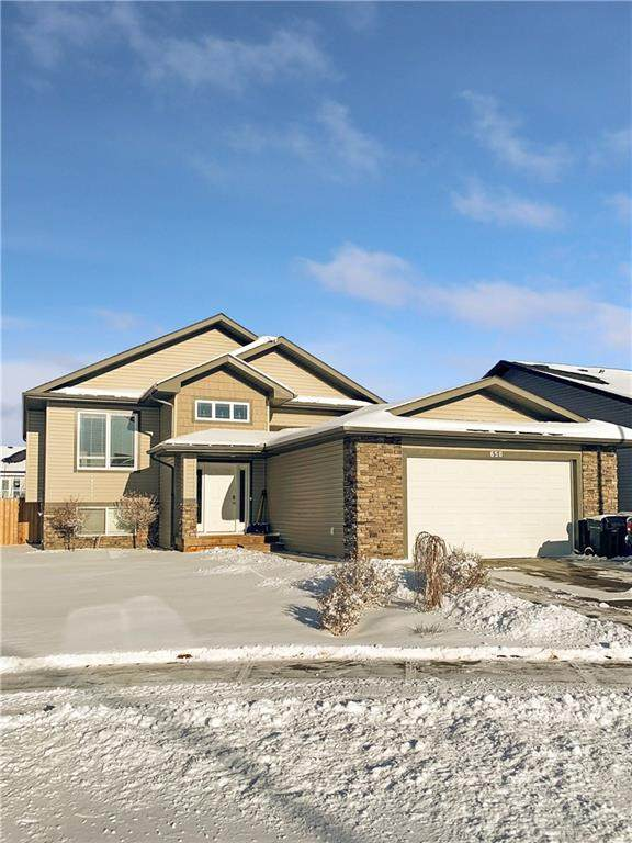 650 West Highland Crescent, Carstairs, AB T0M 0N0 (#C4287003) :: Canmore & Banff