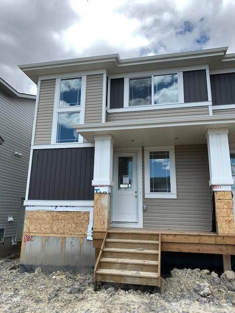 1182 Carrington Blvd NW, Calgary, AB T3P 1L8 (#C4299759) :: Calgary Homefinders