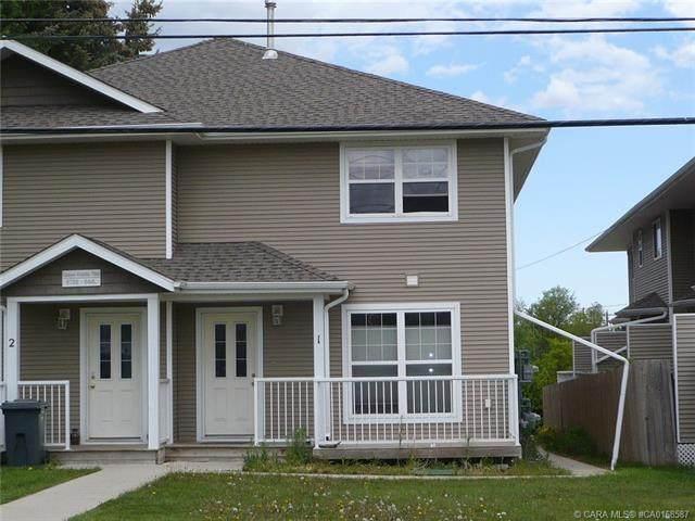 5703 54 Street #1, Ponoka, AB T4J 1M1 (#CA0168587) :: Canmore & Banff